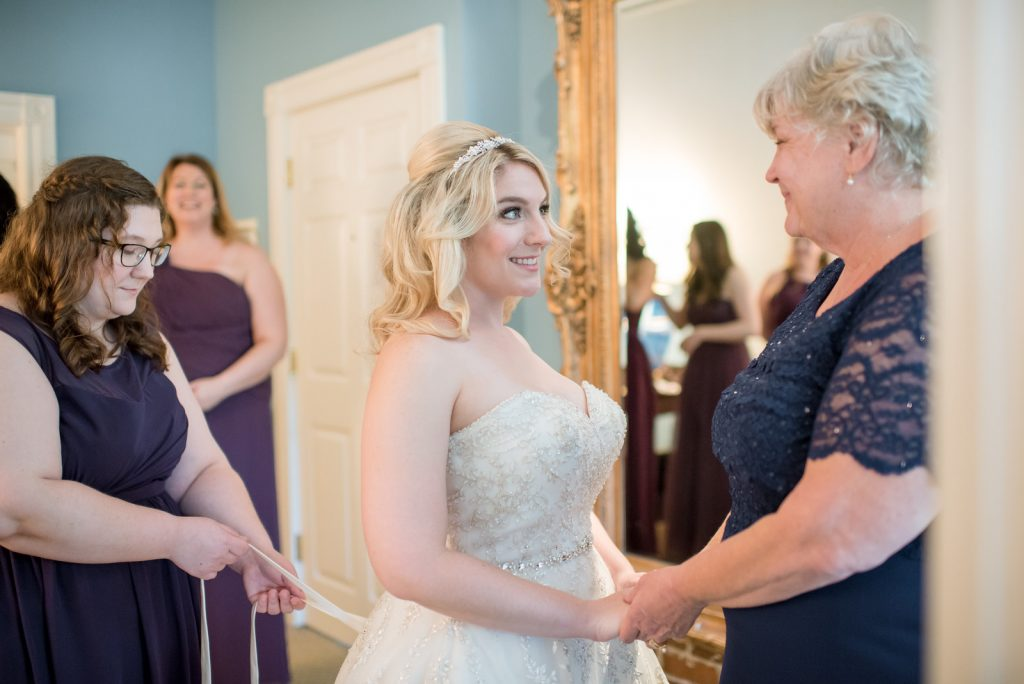 Bride Getting Ready Lace Up | Classic Purple & Orange Wedding Football Texas Longhorns Sports Lake Lucerne Courtyard Anna Christine Events Orlando Kathy Thomas Photography
