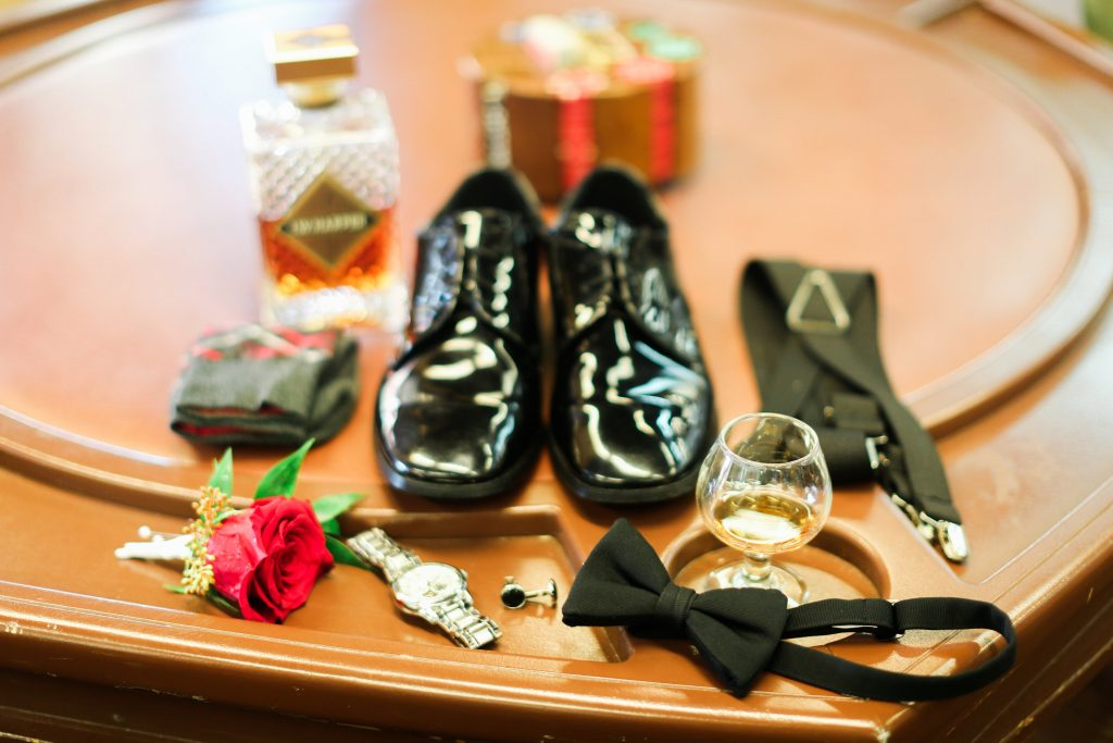 Groomsmen Groom Getting Ready Bourbon Whiskey | Red & Black Wedding Classic Romantic Dark Mission Inn Resort Anna Christine Events Wings of Glory Photography