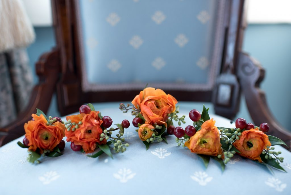 Orange Boutonnieres Flowers by Lesley | Classic Purple & Orange Wedding Football Texas Longhorns Sports Lake Lucerne Courtyard Anna Christine Events Orlando Kathy Thomas Photography