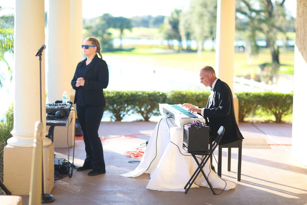 Singer Pianist Spess Neblett Wedding Ceremony | Red & Black Wedding Classic Romantic Dark Mission Inn Resort Anna Christine Events Wings of Glory Photography