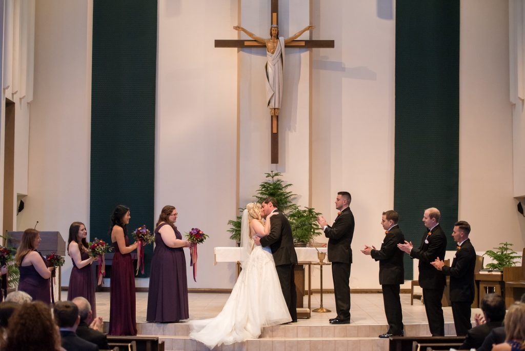 Bride & Groom Ceremony St. Margaret Mary Catholic Church | Classic Purple & Orange Wedding Football Texas Longhorns Sports Lake Lucerne Courtyard Anna Christine Events Orlando Kathy Thomas Photography