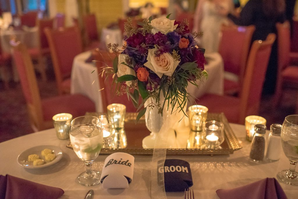 Sweetheart Table Reception Dinner Table Settings | Courtyard at Lake Lucerne Reception | Classic Purple & Orange Wedding Football Texas Longhorns Sports Lake Lucerne Courtyard Anna Christine Events Orlando Kathy Thomas Photography