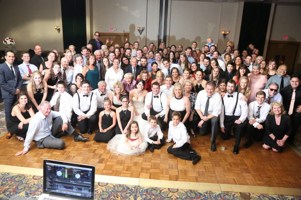 Group Shot Wedding DJ White Rose Entertainment | Red & Black Wedding Classic Romantic Dark Mission Inn Resort Anna Christine Events Wings of Glory Photography