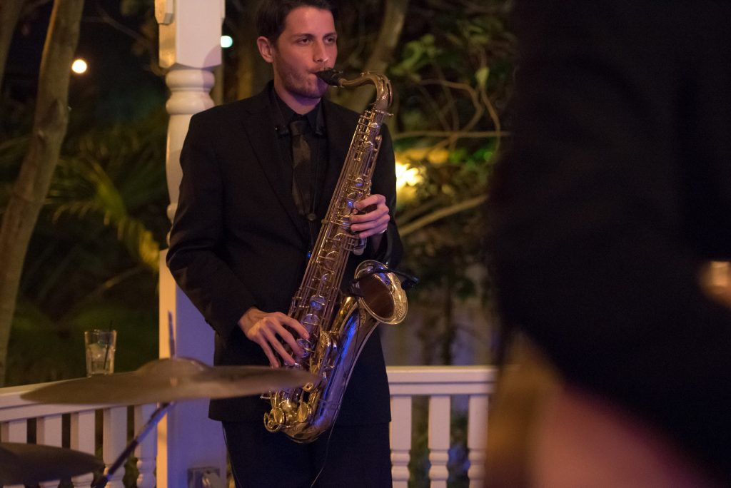 The Bay Kings Band Live Band Saxophone | The Courtyard at Lake Lucerne Classic Purple & Orange Wedding Football Texas Longhorns Sports Lake Lucerne Courtyard Anna Christine Events Orlando Kathy Thomas Photography