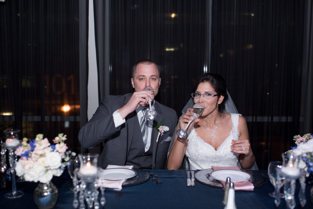 Bride & Groom Sweetheart Table Drinking Champagne | Blue & White Glamorous Wedding The Abbey The Mezz Anna Christine Events Kathy Thomas Photography