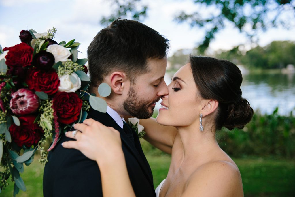 Bride & Groom Kiss | Romantic Red & White Capen House Wedding Geometric Gold Anna Christine Events J Lebron Photography