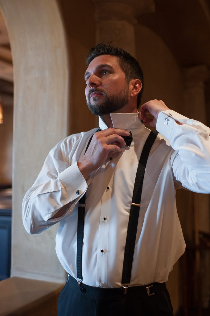 Groom getting ready bowtie | Classic Pink and White Wedding Bella Collina Kathy Thomas Photography Anna Christine Events