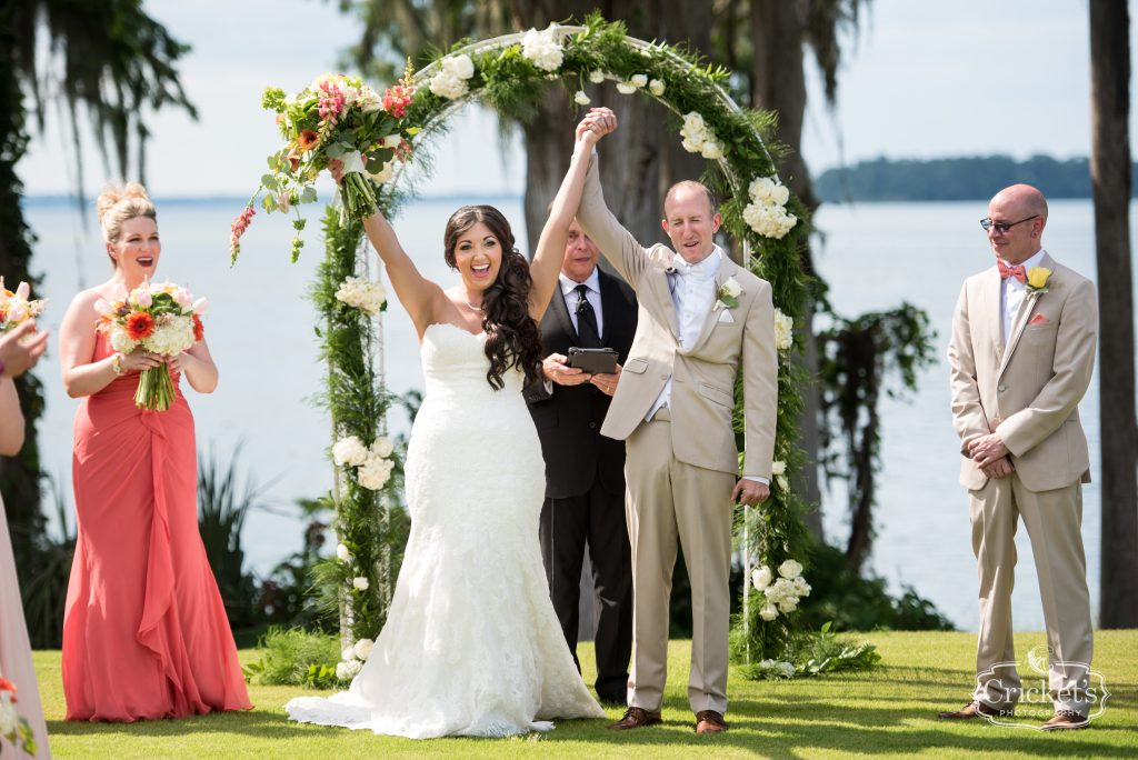 Bride & Groom at Arbor Outdoor Ceremony | Travel Themed Inspired Wedding Mission Inn Resort Orlando Florida Anna Christine Events Cricket's Photo & Cinema