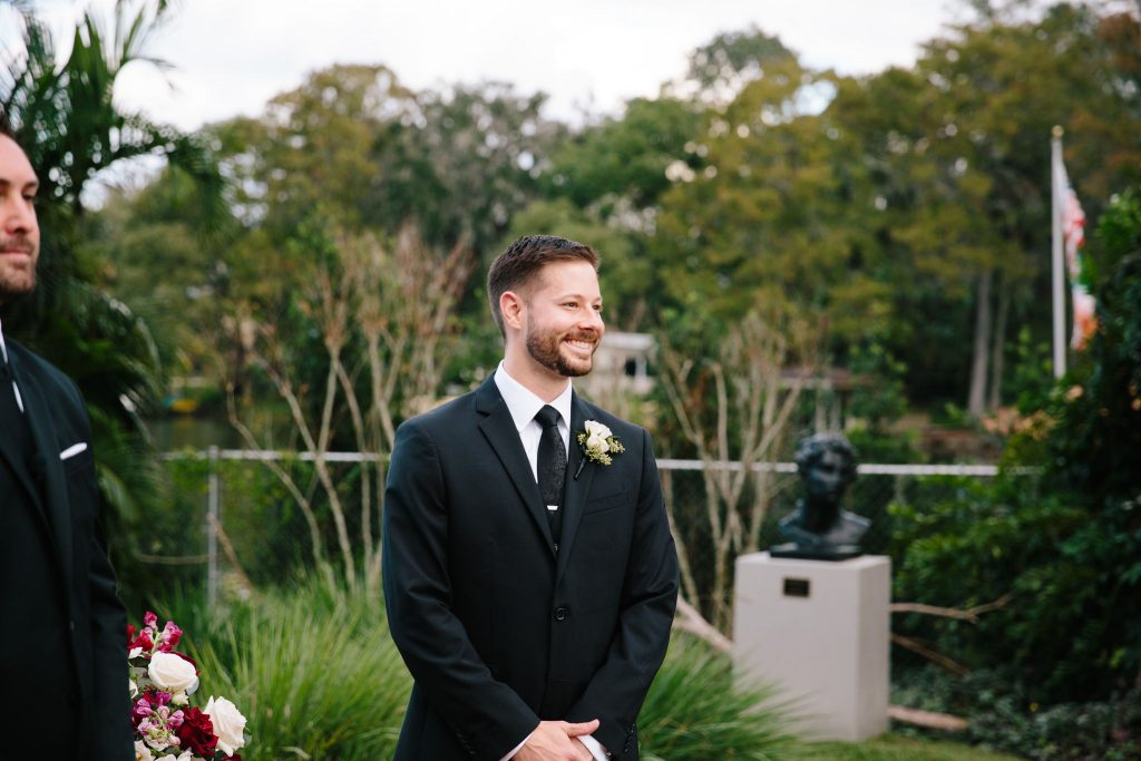 Groom Waiting at Ceremony | Romantic Red & White Capen House Wedding Geometric Gold Anna Christine Events J Lebron Photography