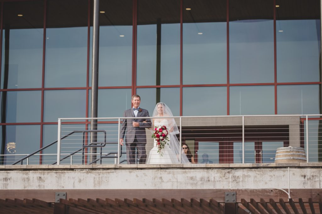 Bride entering from above balcony | Rustic Chic Wedding Romantic Ashley Jane Photography Streamsong Resort Florida Orlando Wedding Planner Anna Christine Events