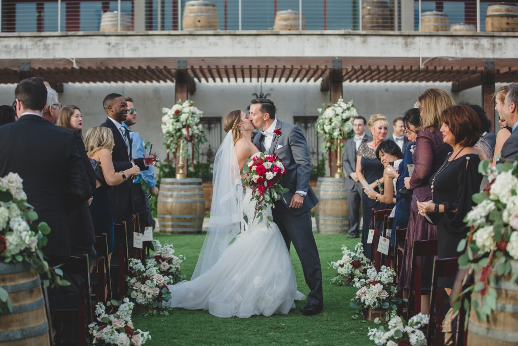 Bride & groom kissing at ceremony outdoors | Rustic Chic Wedding Romantic Ashley Jane Photography Streamsong Resort Florida Orlando Wedding Planner Anna Christine Events