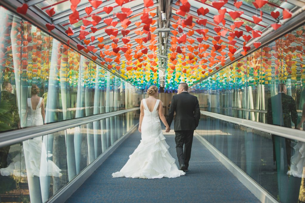 Bride & groom colorful rainbow first look | Nerd Geek Chic Wedding Theme Game of Thrones Harry Potter Super Mario Orlando Science Center Anna Christine Events Orlando Wedding Planner Ashley Jane Photography