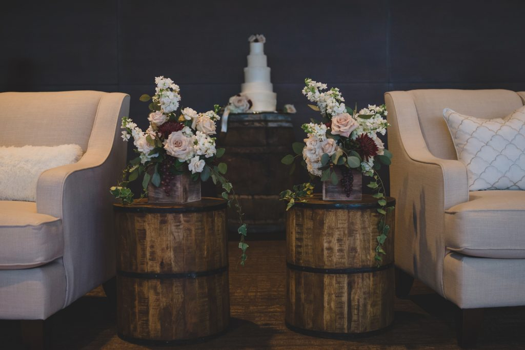Barrels with flowers | Rustic Chic Wedding Romantic Ashley Jane Photography Streamsong Resort Florida Orlando Wedding Planner Anna Christine Events