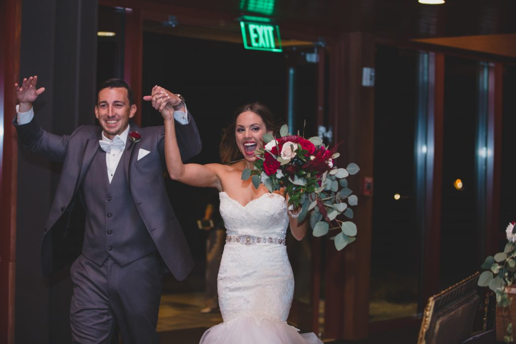 Bride & groom entering reception | Rustic Chic Wedding Romantic Ashley Jane Photography Streamsong Resort Florida Orlando Wedding Planner Anna Christine Events