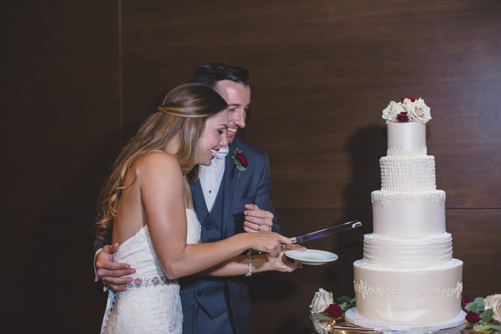 Bride & groom cutting the cake | Rustic Chic Wedding Romantic Ashley Jane Photography Streamsong Resort Florida Orlando Wedding Planner Anna Christine Events