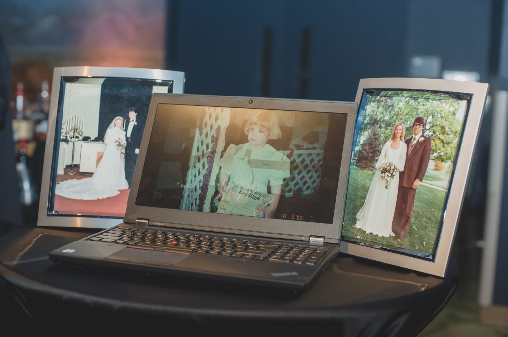 Wedding slideshow on laptop | Nerd Geek Chic Wedding Theme Game of Thrones Harry Potter Super Mario Orlando Science Center Anna Christine Events Orlando Wedding Planner Ashley Jane Photography