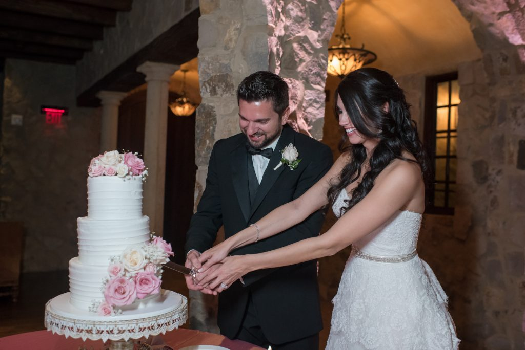 Bride & groom cutting cake | Classic Pink and White Wedding Bella Collina Kathy Thomas Photography Anna Christine Events