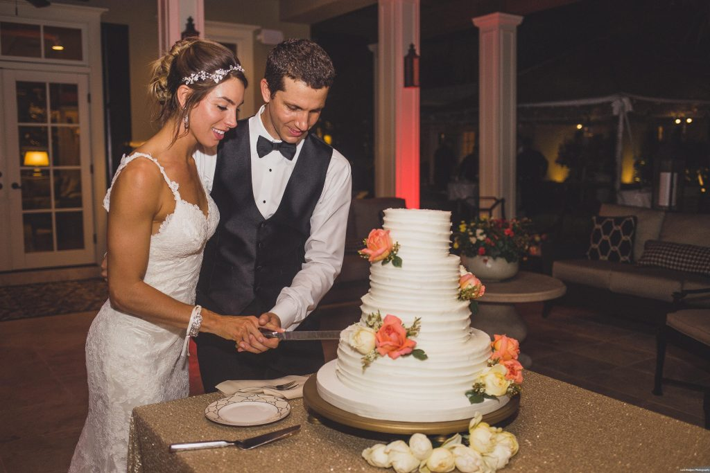 Bride & groom cutting wedding cake | Bright Backyard Wedding Colorful Lora Rodgers Photography Anna Christine Events