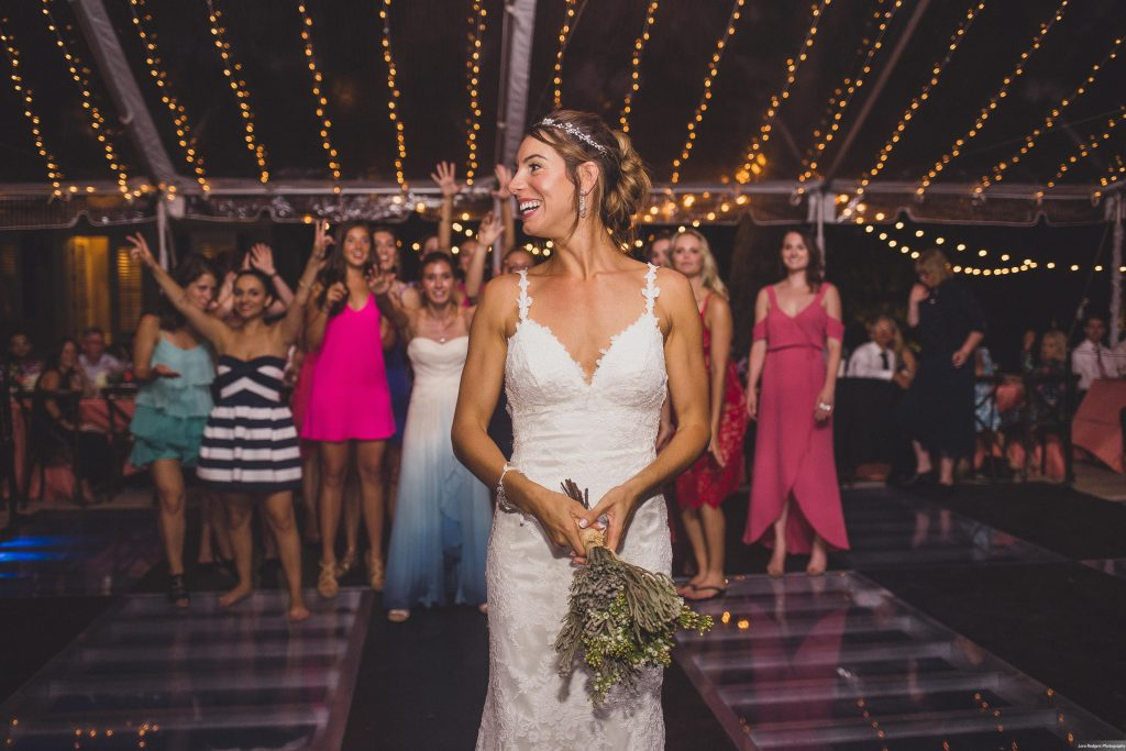 Bride tossing bouquet | Bright Backyard Wedding Colorful Lora Rodgers Photography Anna Christine Events