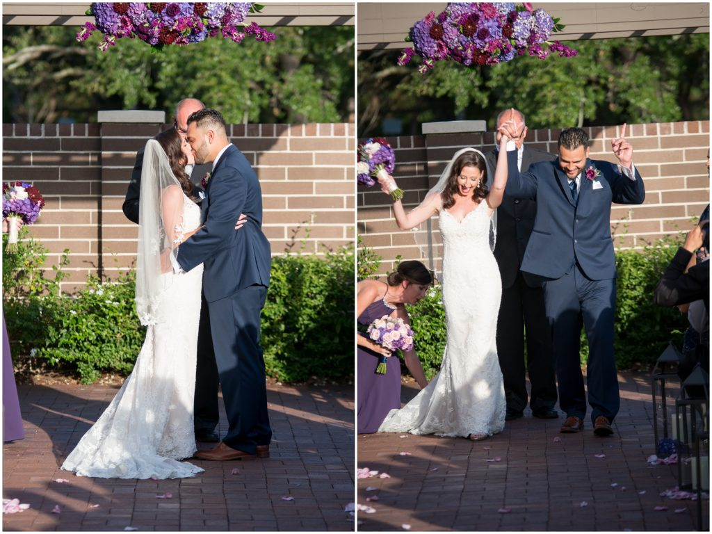 Bride & groom first kiss ceremony | Classic Purple & White Wedding Photography Noah's Event Venue Orlando Florida Anna Christine Events Wedding Planner Jessica Leigh