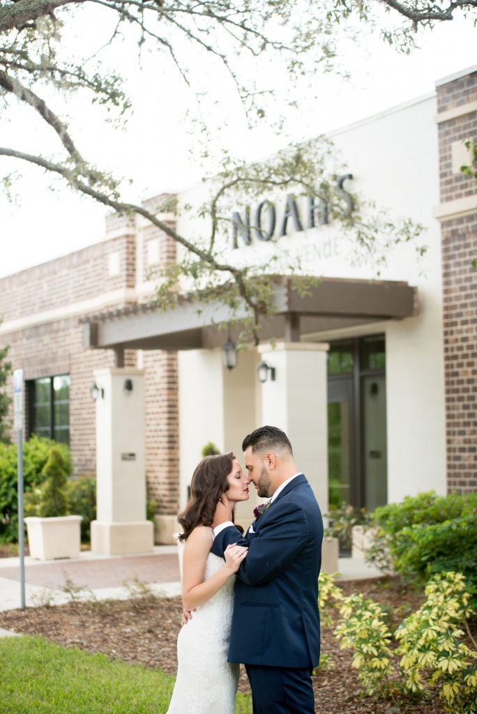 Bride & groom first look outside venue | Classic Purple & White Wedding Photography Noah's Event Venue Orlando Florida Anna Christine Events Wedding Planner Jessica Leigh