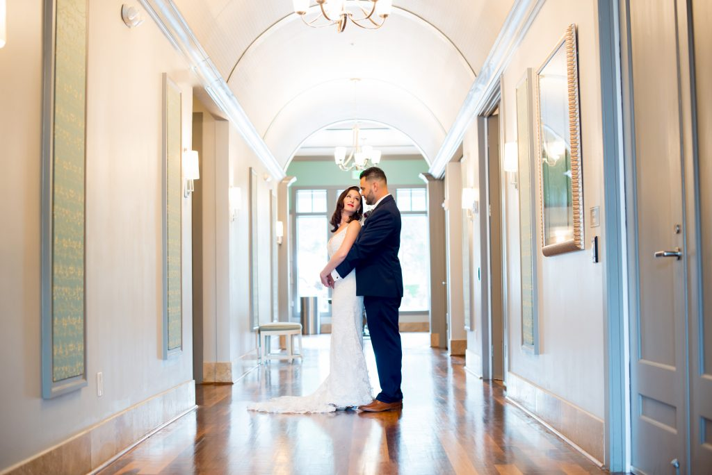 Bride & groom in hallway | Classic Purple & White Wedding Photography Noah's Event Venue Orlando Florida Anna Christine Events Wedding Planner Jessica Leigh