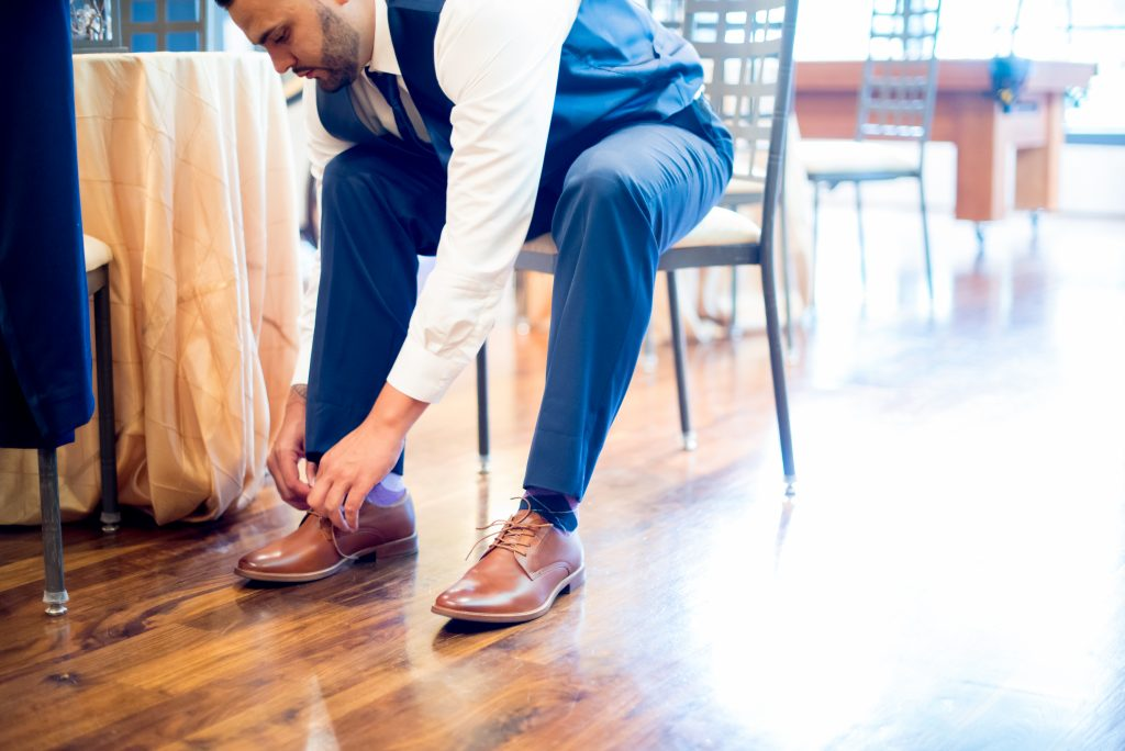 Groom getting ready shoes | Classic Purple & White Wedding Photography Noah's Event Venue Orlando Florida Anna Christine Events Wedding Planner Jessica Leigh