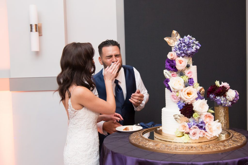 Cutting the cake | Classic Purple & White Wedding Photography Noah's Event Venue Orlando Florida Anna Christine Events Wedding Planner Jessica Leigh